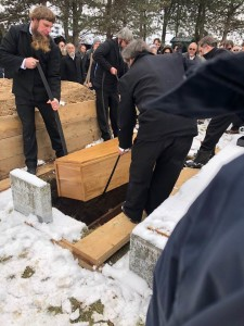 A funeral lowering coffin